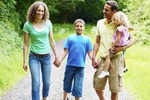 Summer-family-walking-in-park-resized