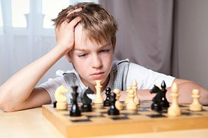 Preteen-playing-chess